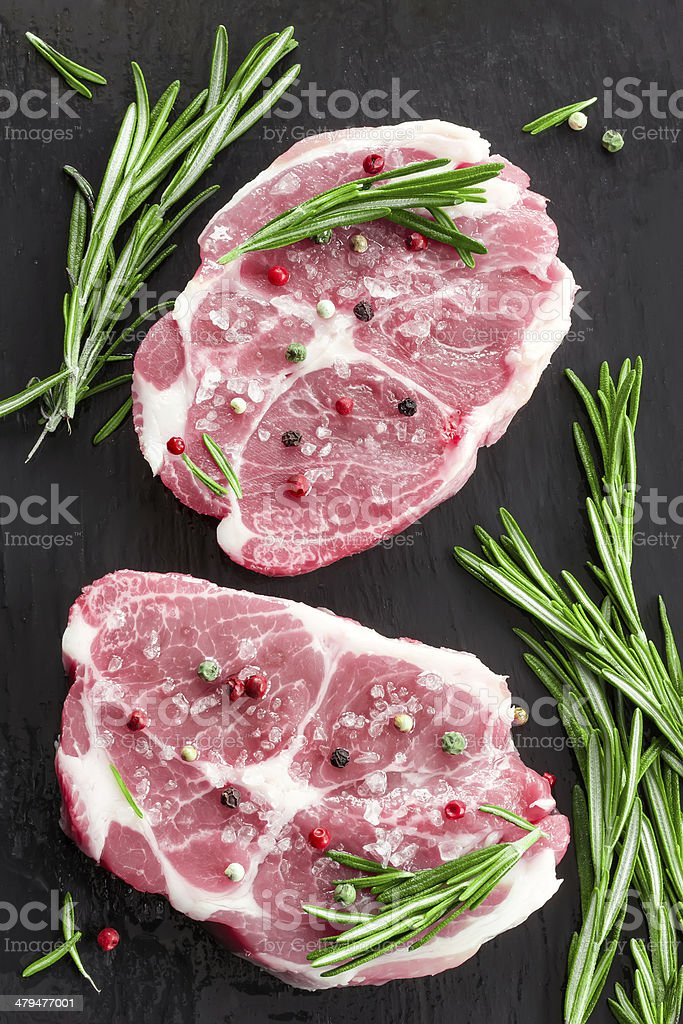 Raw steaks stock photo