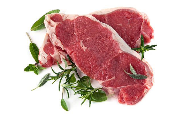raw steaks with herbs - strip steak stockfoto's en -beelden