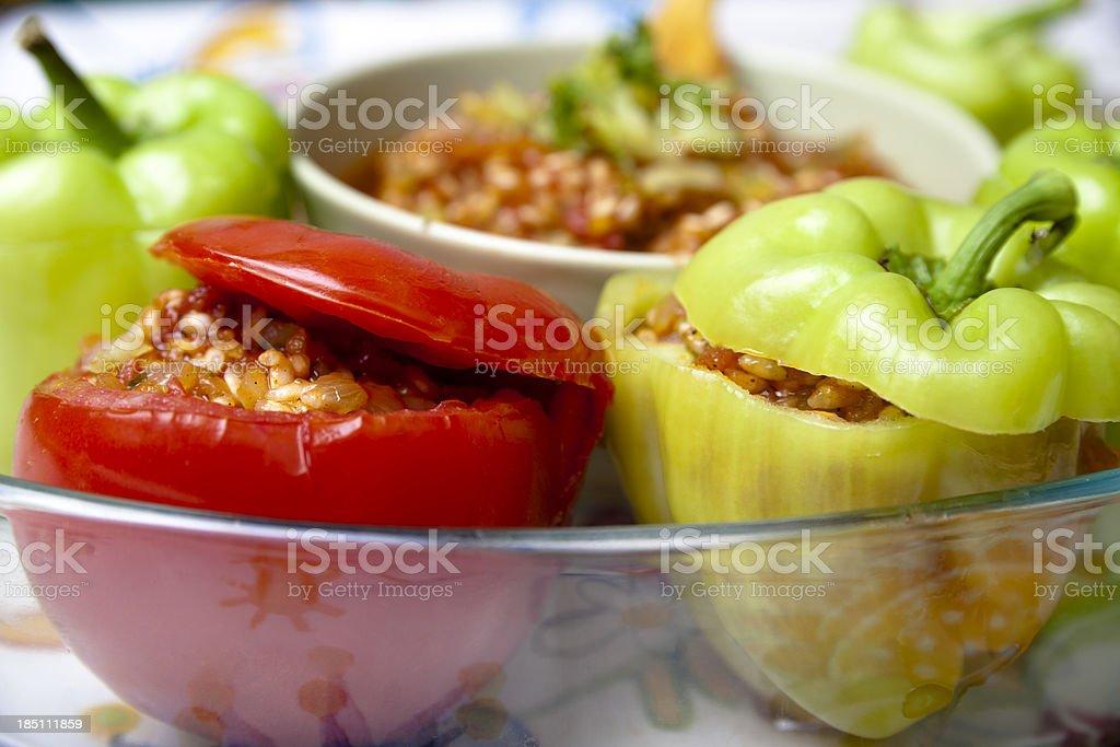 Raw stuffed peppers & tomatoes stock photo