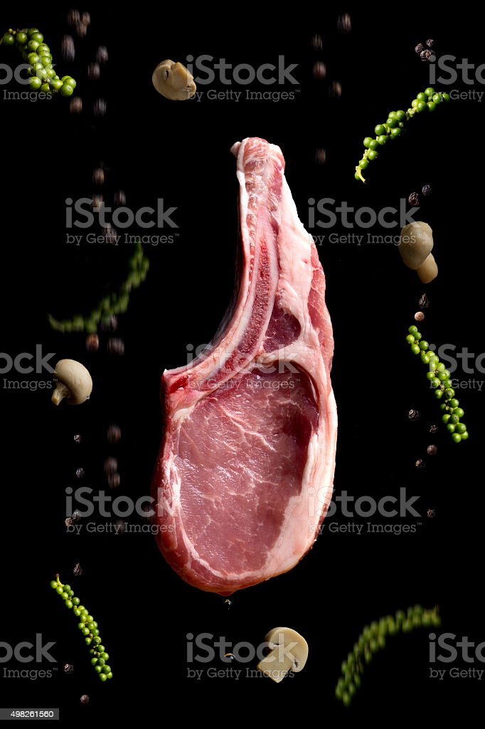 Raw T-Bone Steak and herbs stock photo