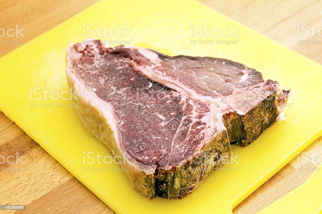 raw t-bone steak stock photo