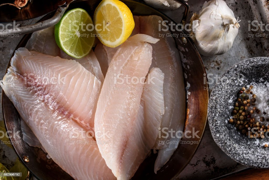 Raw Tilapia Fillet with Spices foto de stock royalty-free