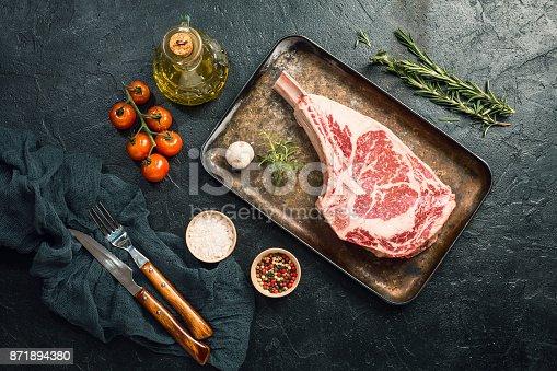 istock Raw tomahawk beef steak 871894380