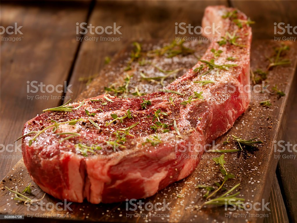 Raw Tomahawk Steak stock photo