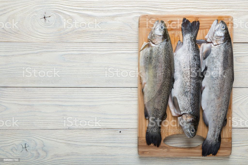 Raw trout on a wooden background – Foto