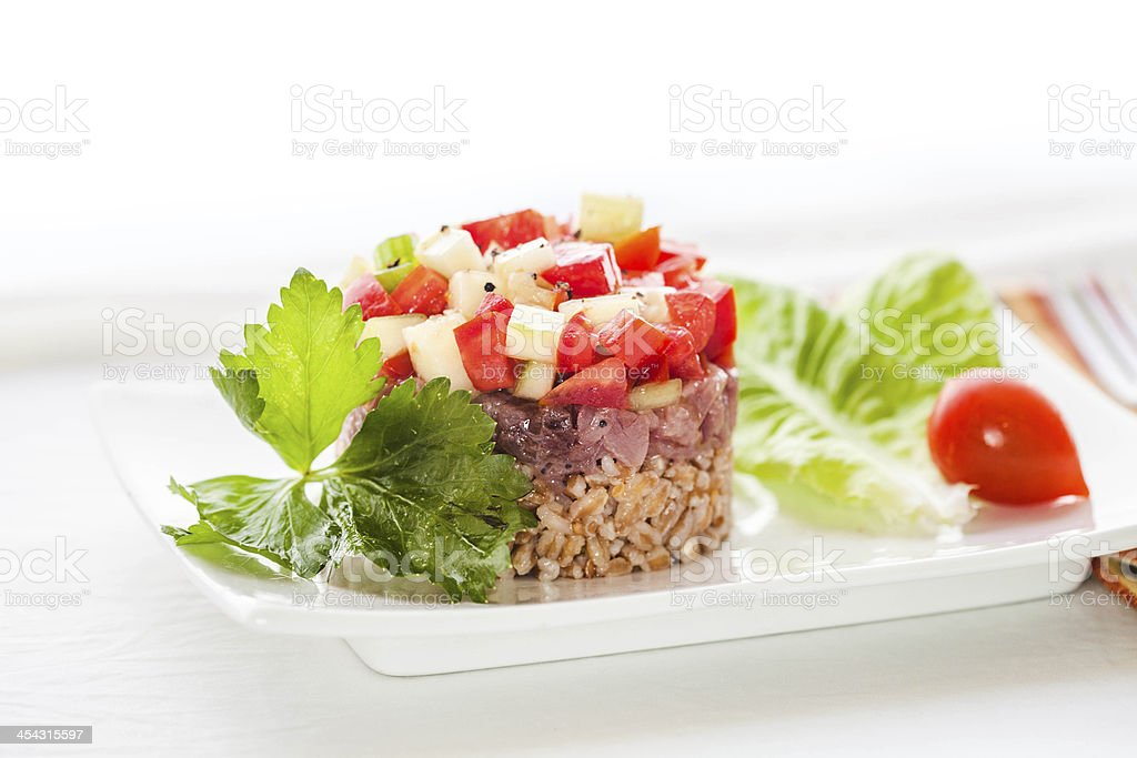 Raw Tuna Tartare with Vegetables and Spelt royalty-free stock photo