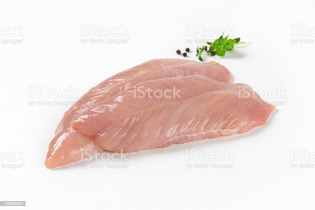 raw turkey breast fillets stock photo