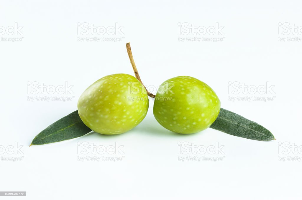 Raw Turkish Fresh Aegean Green Olive Seeds And Leaves On White