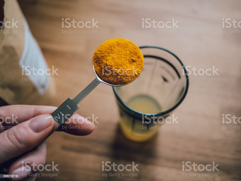 Raw turmeric curcuma powder stock photo