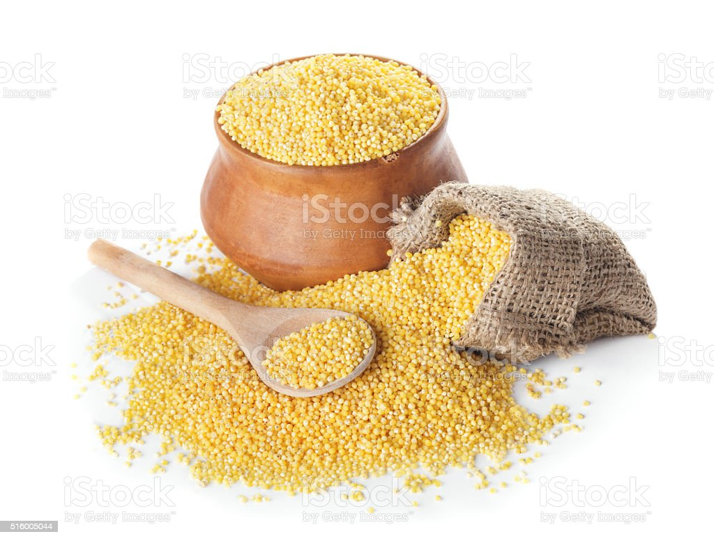 Raw uncooked millet in bowl and a bag stock photo