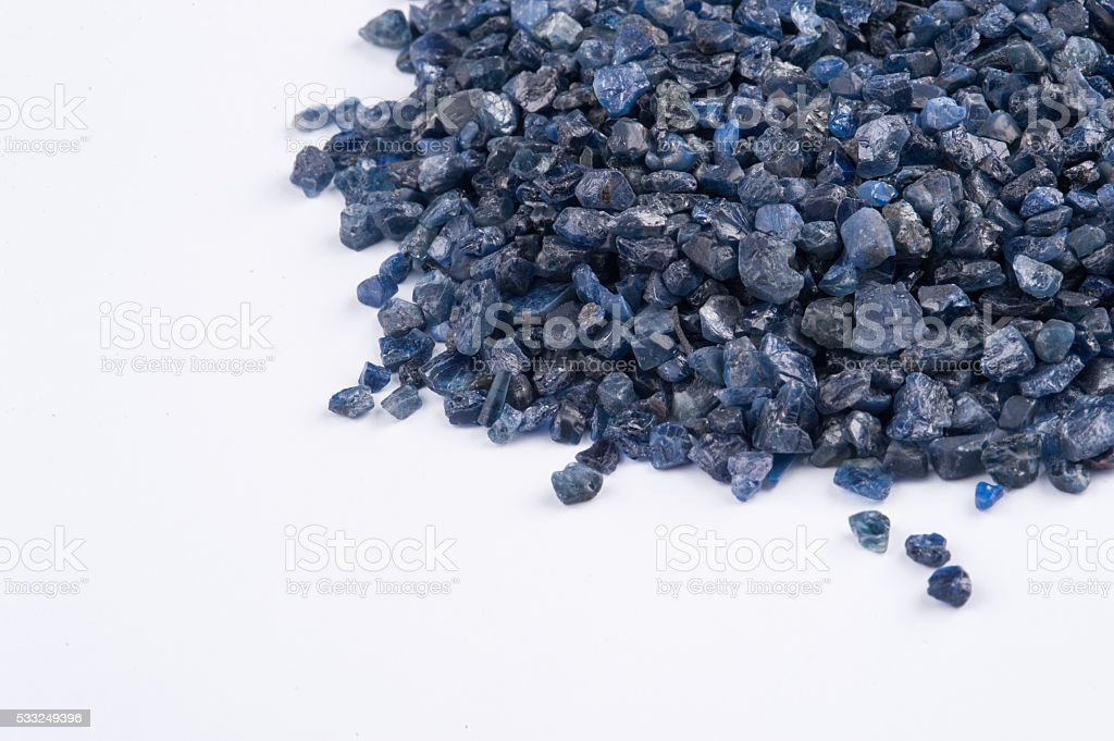 Raw, uncut and rough blue Sapphire crystals. stock photo
