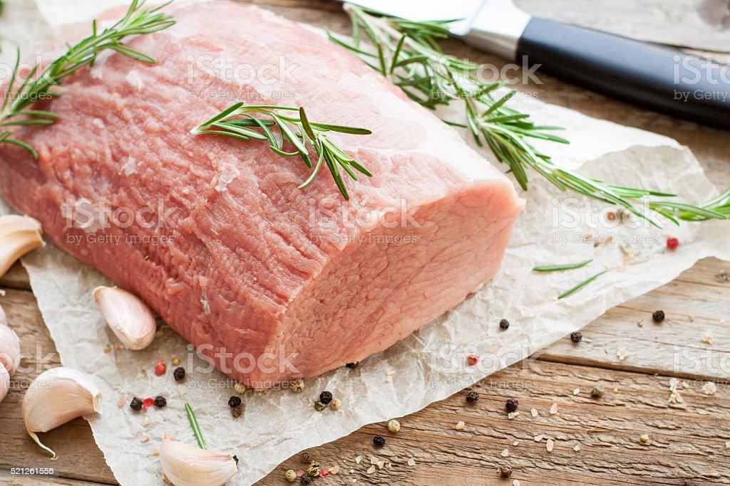Raw veal tenderloin on wooden table stock photo