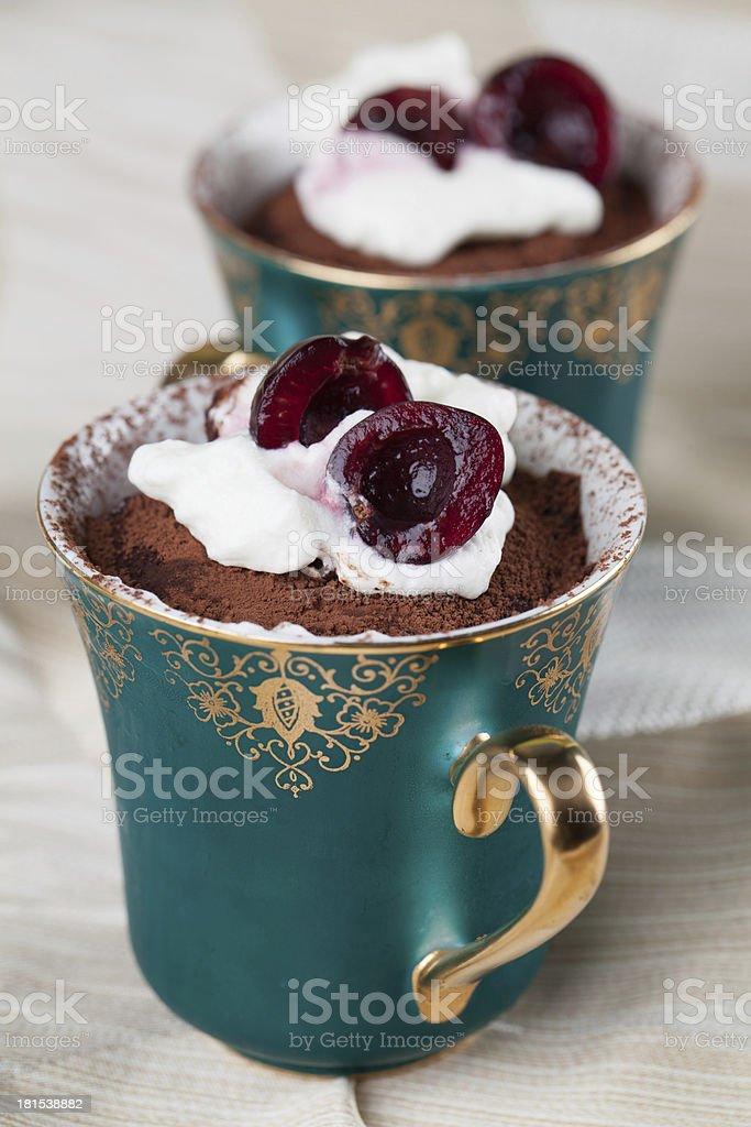 Raw vegan avocado chocolate mousse with cherries stock photo