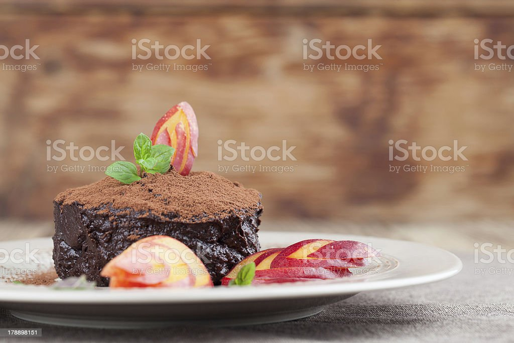 Raw vegan avocado chocolate mousse with nectarine stock photo