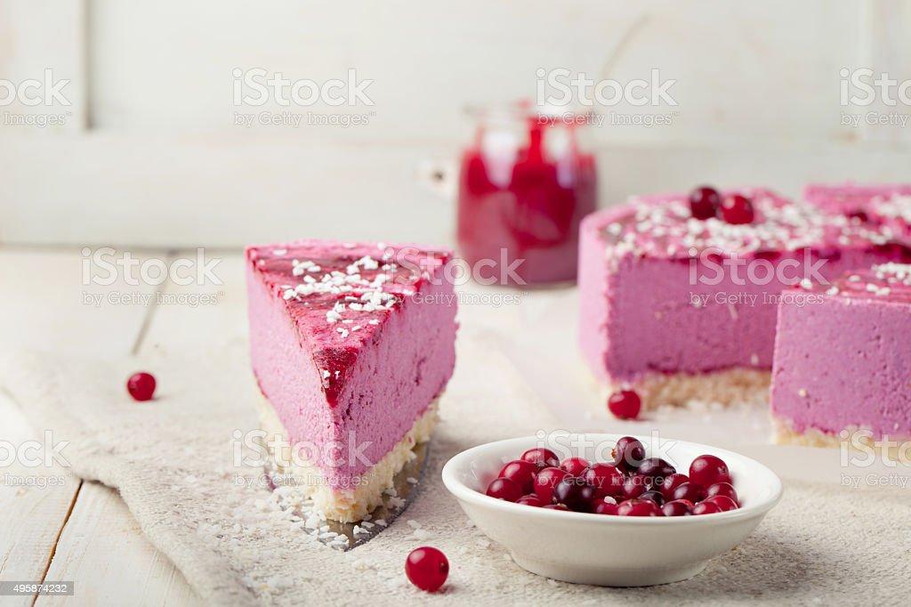 Raw vegan berry cheesecake gluten free. Wooden background stock photo