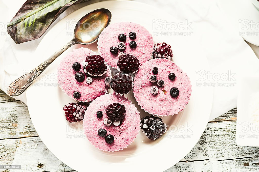 raw vegan berry cheesecake with coconut, top view royalty-free stock photo