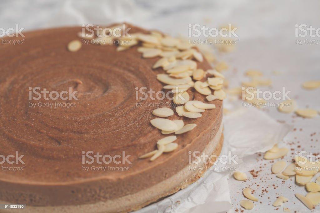 Raw vegan chocolate-caramel cheesecake. Healthy vegan food concept. Macro stock photo