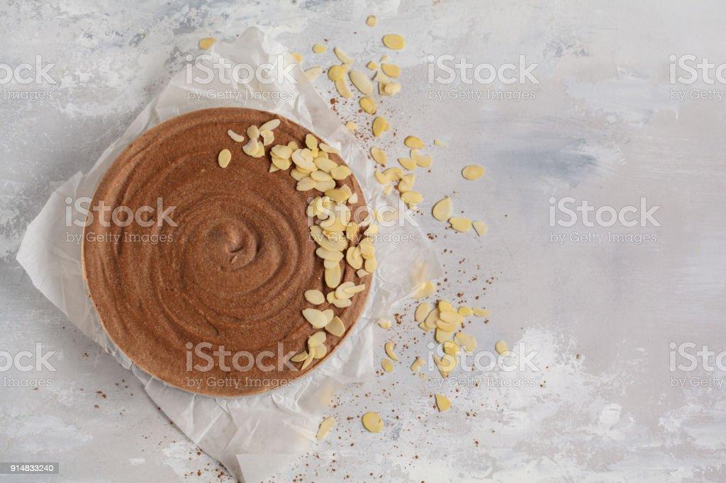Raw vegan chocolate-caramel cheesecake. Healthy vegan food concept. Top view stock photo
