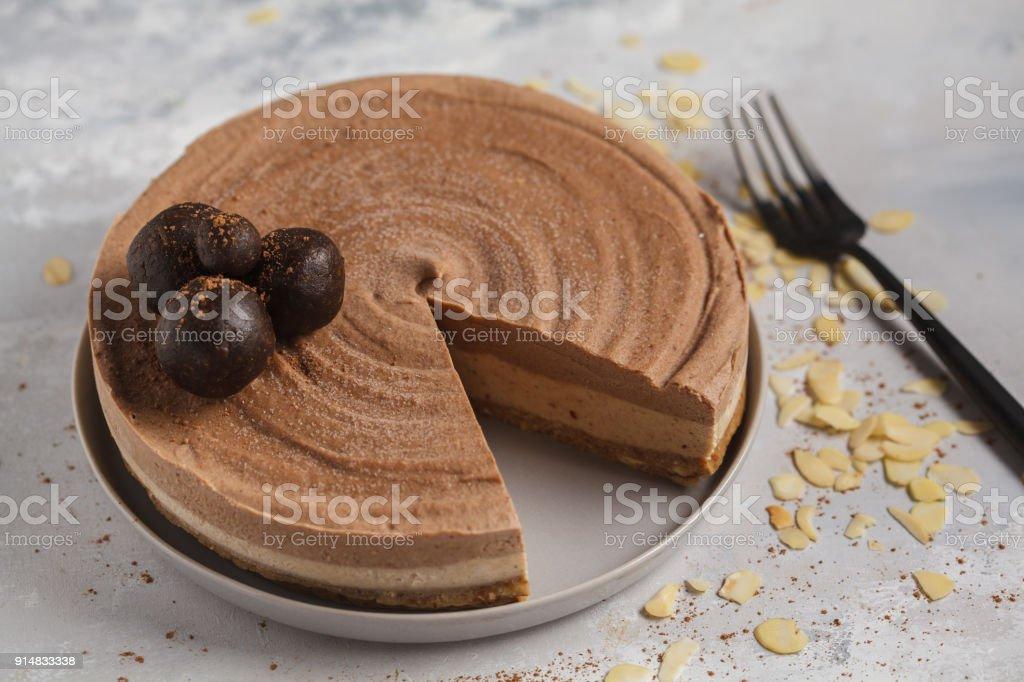 Raw vegan chocolate-caramel cheesecake with raw balls. Healthy vegan dessert food concept. stock photo