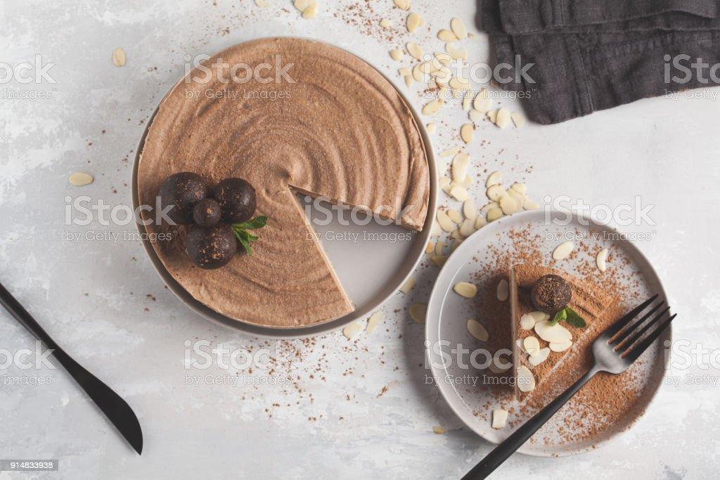 Raw vegan chocolate-caramel cheesecake with raw balls. Healthy vegan food concept. Top view stock photo