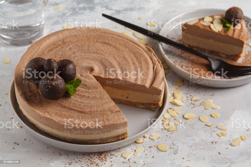 Raw vegan chocolate-caramel cheesecake with raw balls. Healthy vegan food concept. stock photo