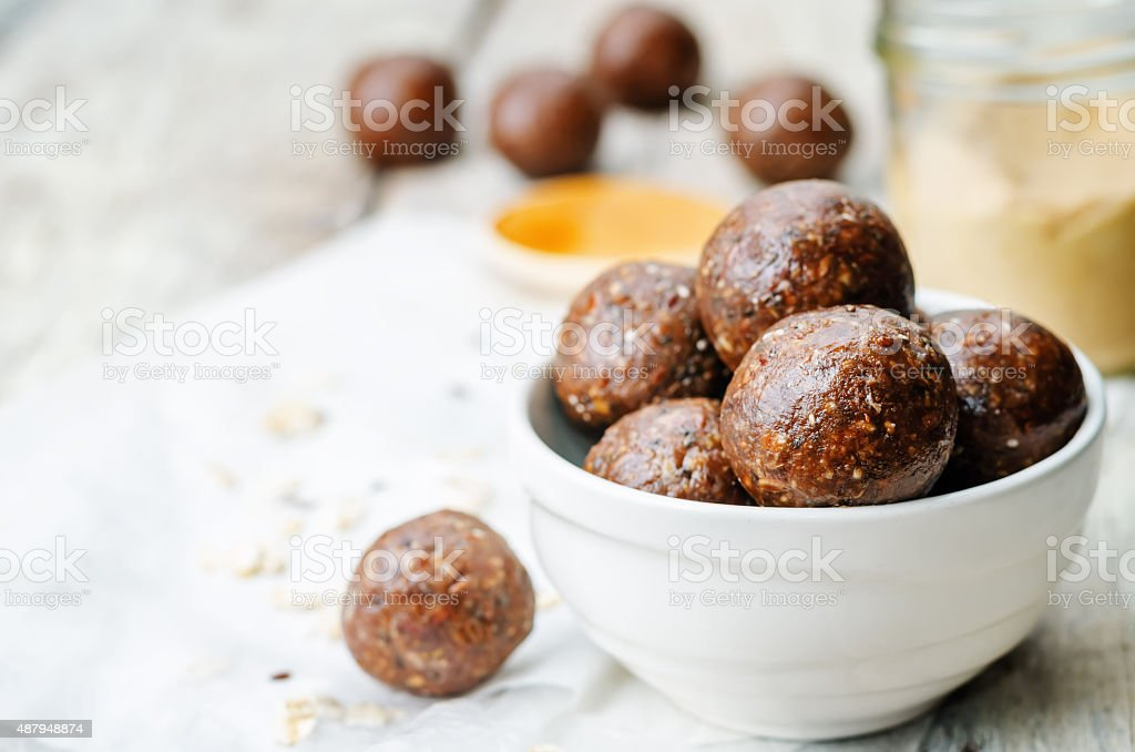 Raw vegan peanut butter oat coconut cacao balls stock photo