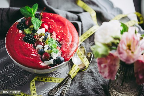 Raw Vegan Smoothie Bowl with different kinds of berries and mint