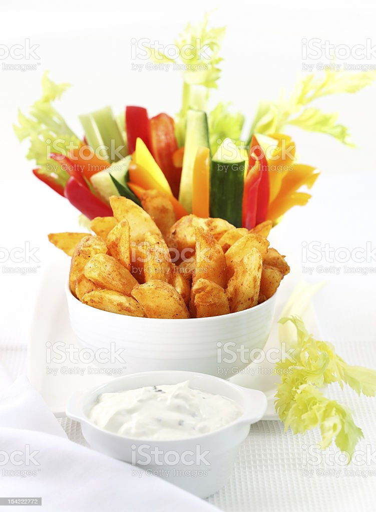 Raw vegetable and wedges with dip royalty-free stock photo