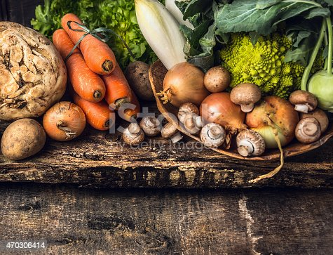 raw vegetables and edible root various on dark wooden rustic background