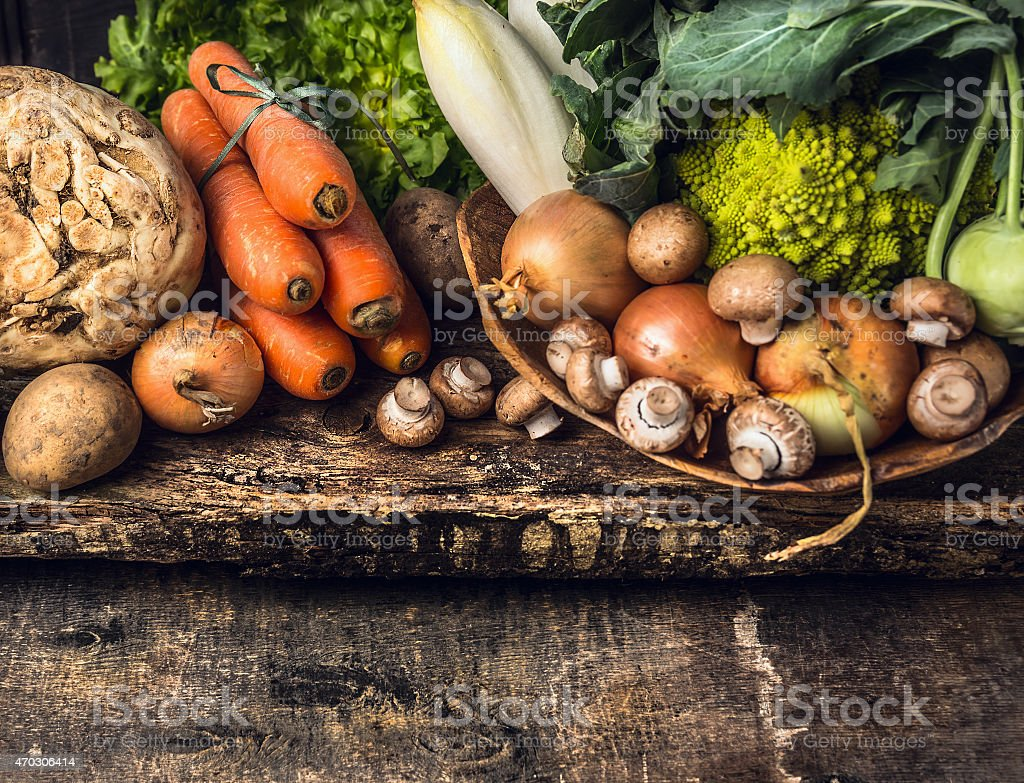 raw vegetables and edible root various on dark  rustic background stock photo