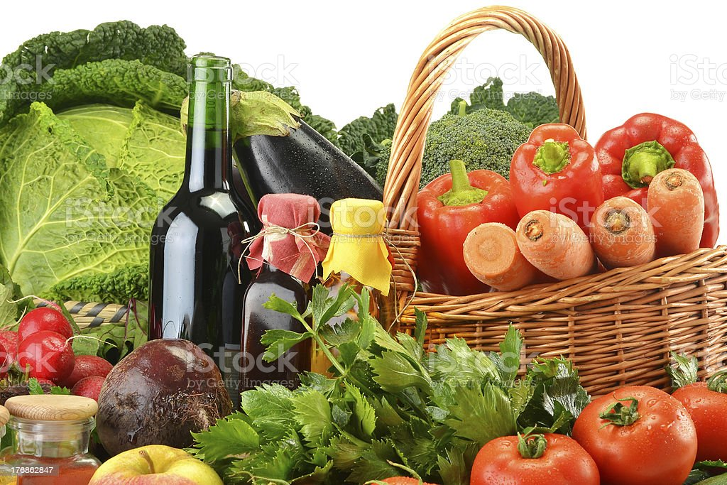 Raw vegetables and wicker basket isolated on white royalty-free stock photo