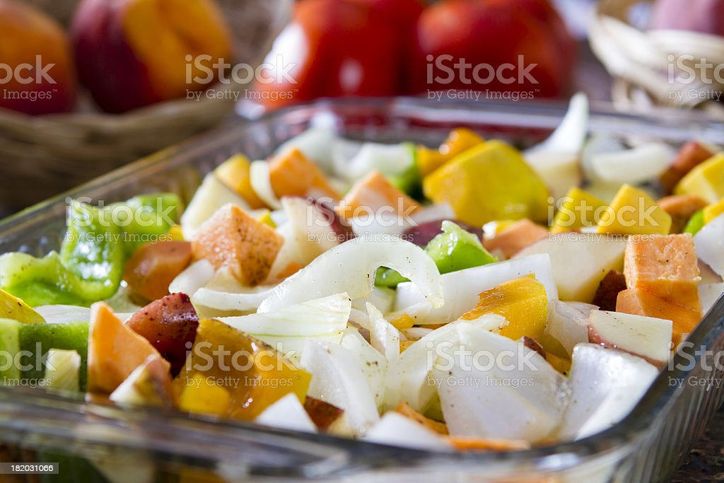 Raw vegetables in a baking pan ready for roasting. royalty-free stock photo