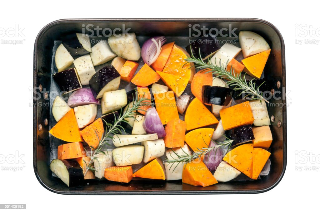 Raw Vegetables in Baking Pan Top View Isolated stock photo