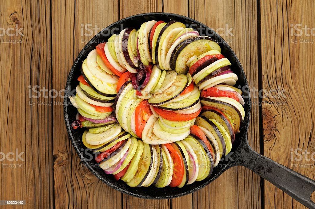 Raw vegetables layed for ratatouille made of eggplants, squash stock photo