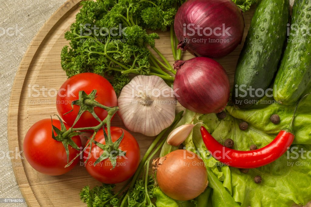raw vegetables on a round wooden Board. royalty-free stock photo