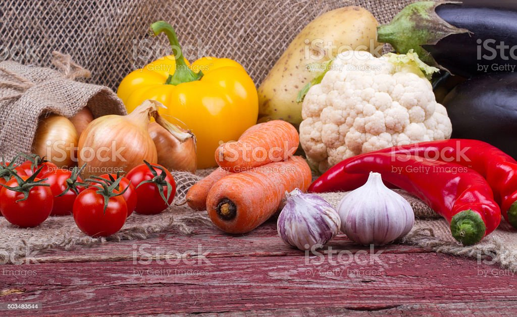 Raw vegetables on a wooden table stock photo
