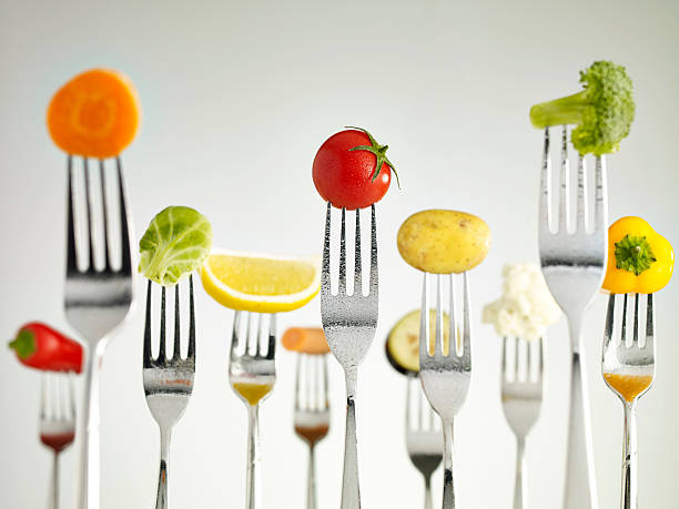 raw vegetables on forks - food and drink stock photos and pictures