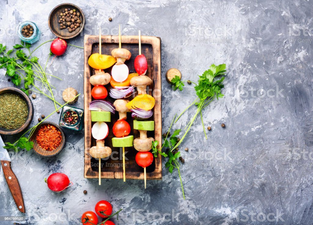 Raw vegetables on skewers royalty-free stock photo