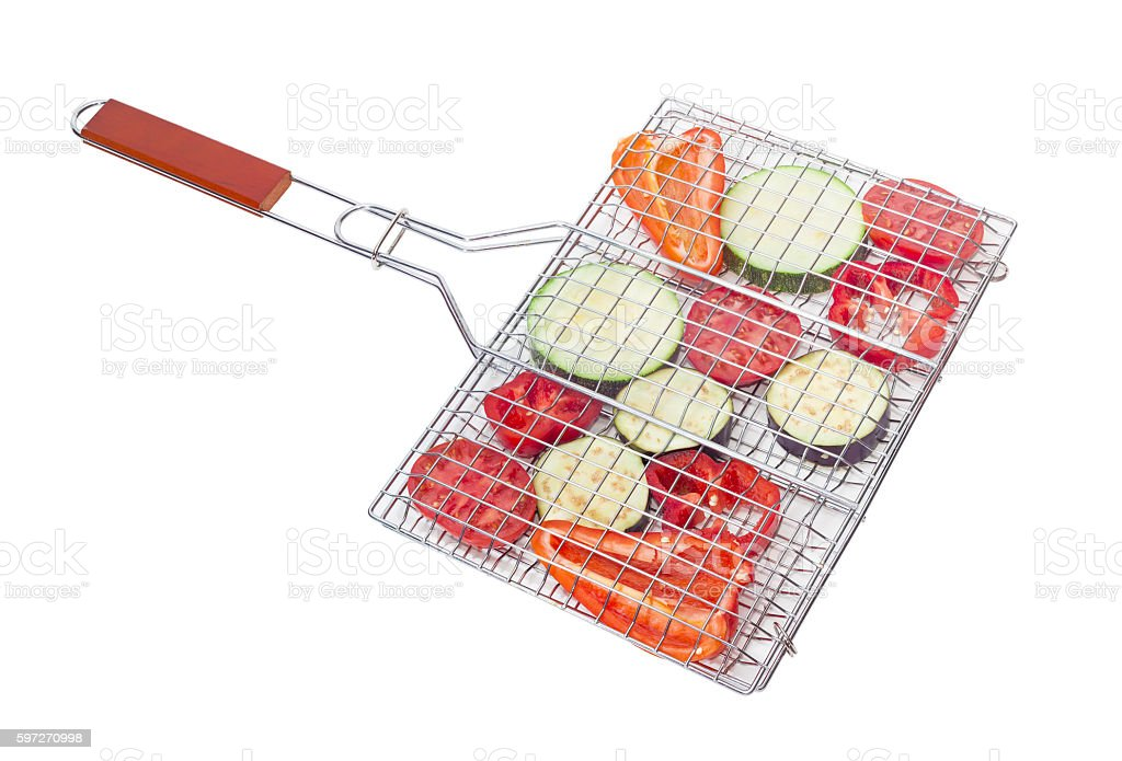 Raw vegetables prepared for grilling on a cooking grates Lizenzfreies stock-foto