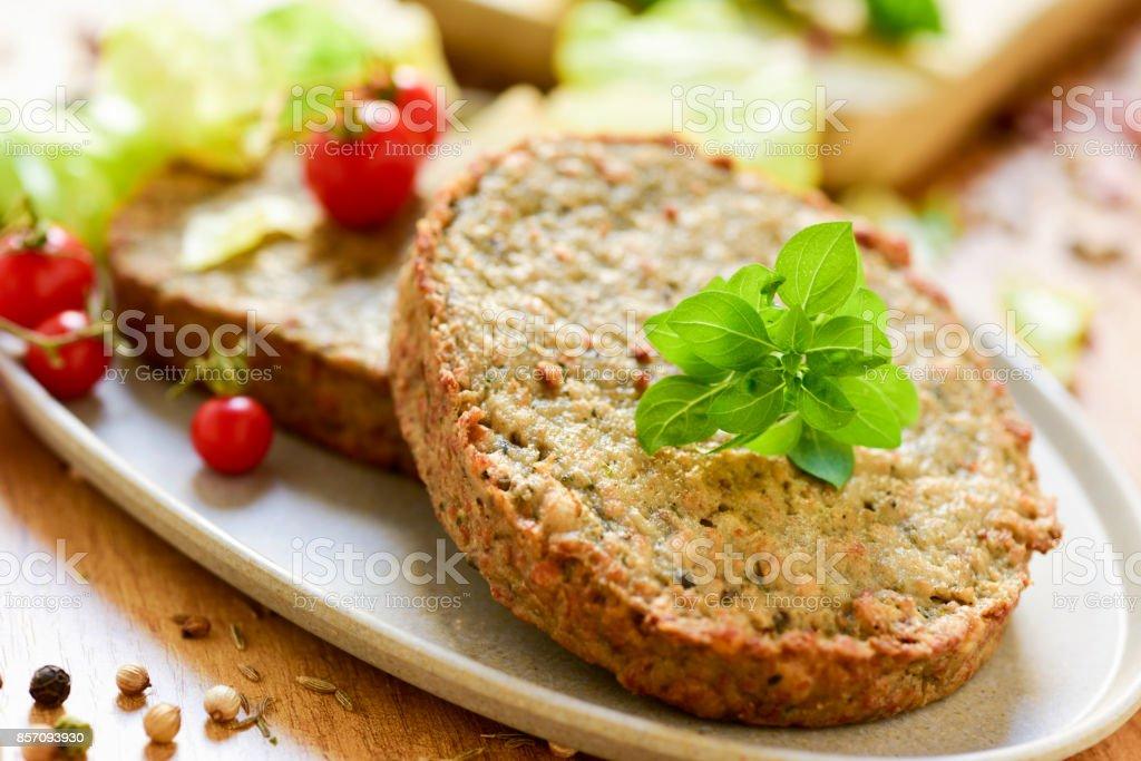 raw veggie burgers stock photo