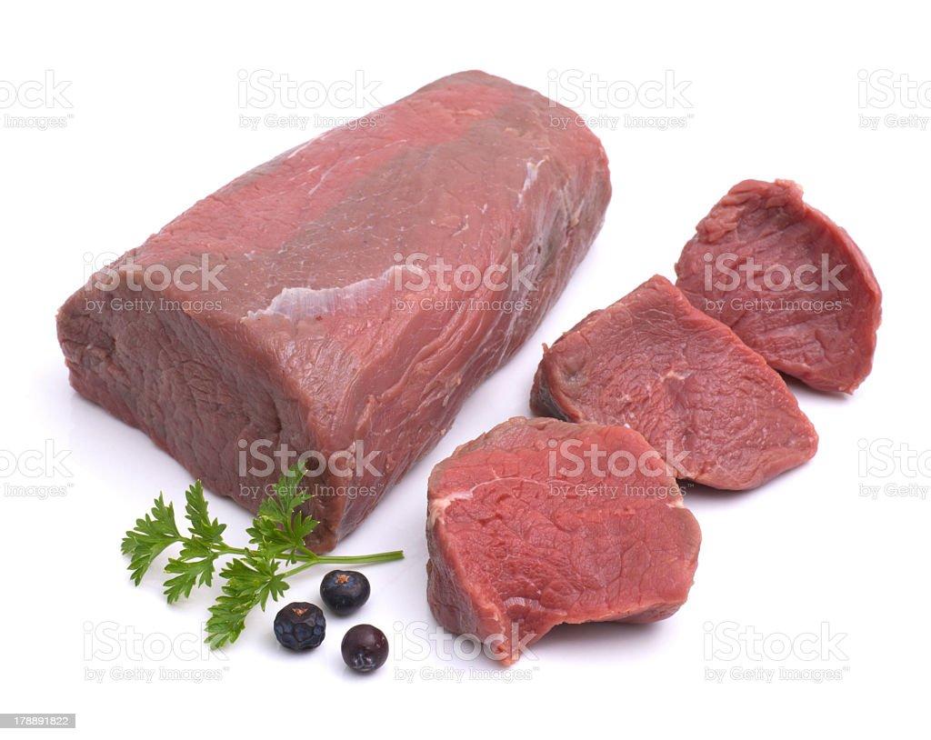 Raw venison with garnishment against white background stock photo