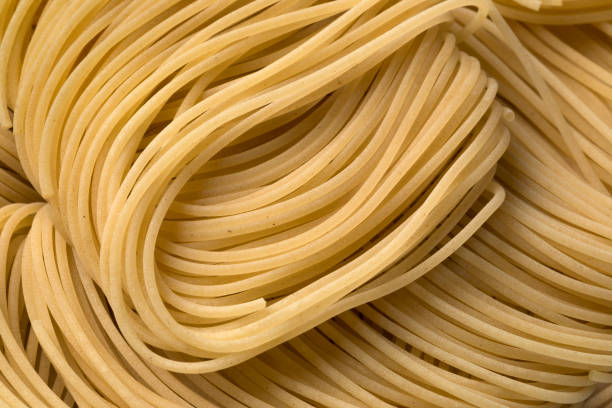 Raw vermicelli Raw vermicelli full frame uncooked pasta stock pictures, royalty-free photos & images