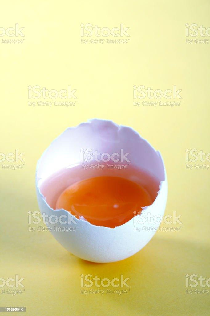 Raw White Egg on Yellow Background royalty-free stock photo