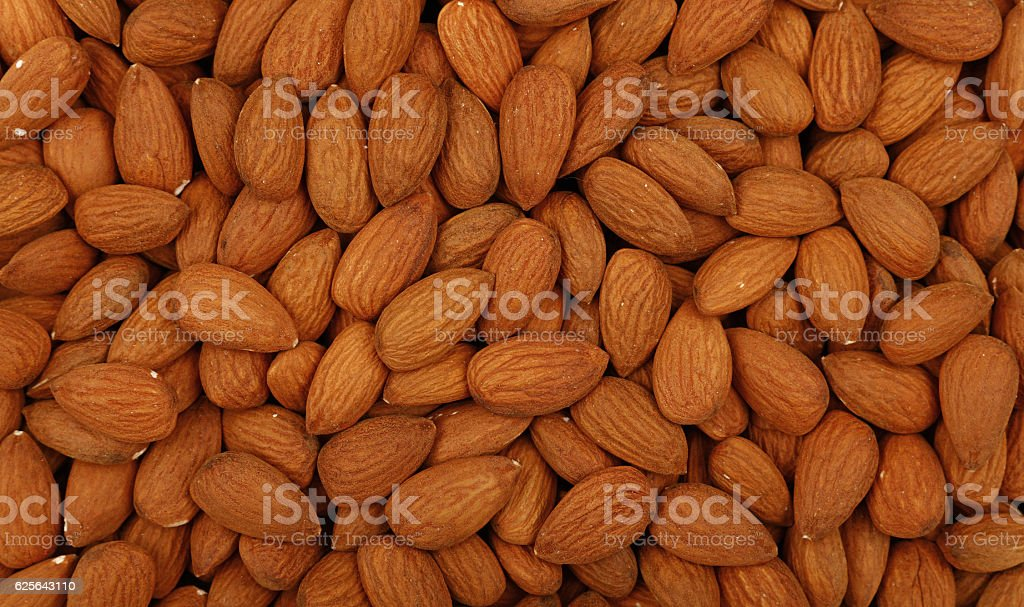 Raw whole almond nuts close up top view stock photo