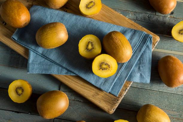 Raw Yellow Organic Golden Kiwis Raw Yellow Organic Golden Kiwis Ready to Eat kiwi fruit stock pictures, royalty-free photos & images