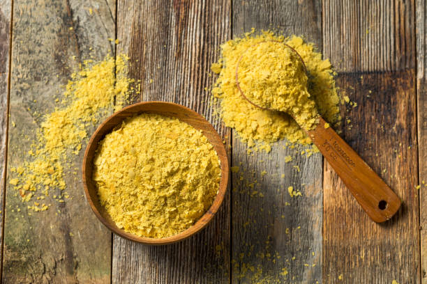 Raw Yellow Organic Nutritional Yeast Raw Yellow Organic Nutritional Yeast in a Bowl yeast stock pictures, royalty-free photos & images