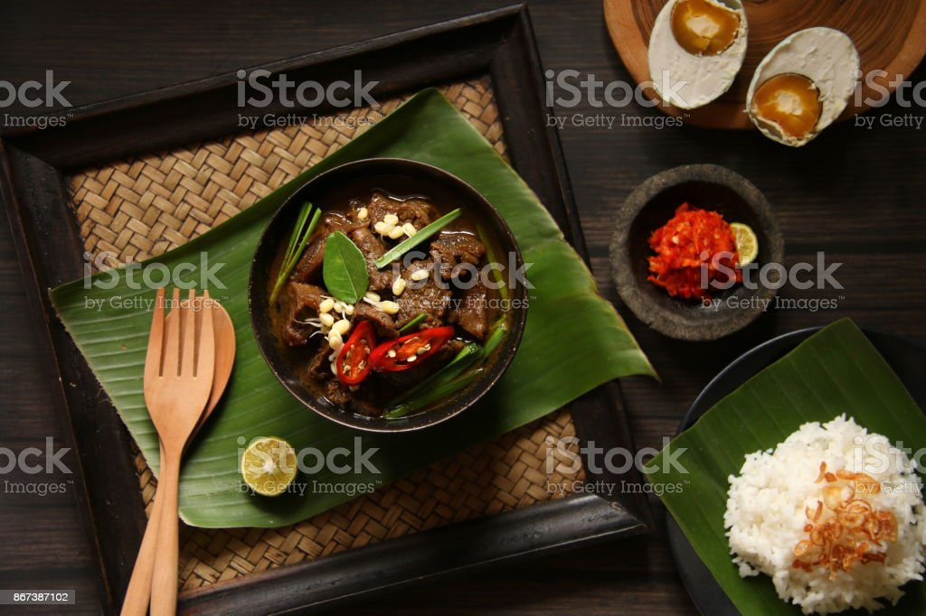 Rawon, a Traditional Javanese Beef Soup in Keluak Fruit Broth stock photo