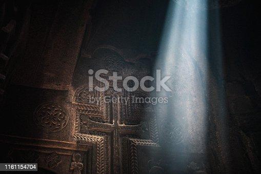 Ray of Hope. Sunbeam at aged temple Armenia