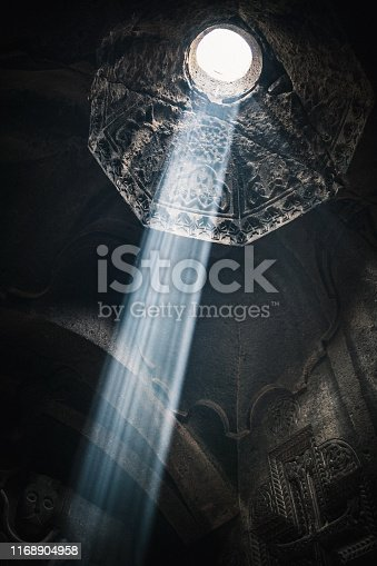 istock Ray of light falling through a dome of aged monastery 1168904958
