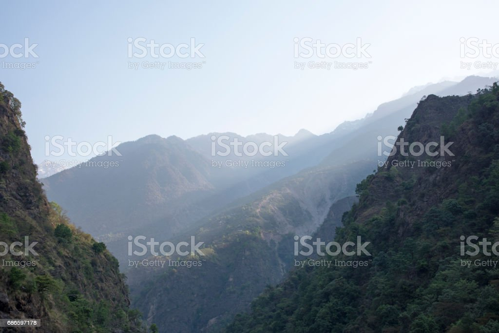 Ray of light filtering the mountains in Nepal royalty-free stock photo